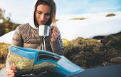 Girl Hold In Hands Cup Of Drinks, Relax Tourist Look On Map, People Planning Trip In Snow Mountain,  poster