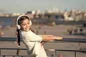 Dont Stop The Music. Happy Girl Wear Headphones. Little Music Fan. Little Child Listen To Music Outd poster