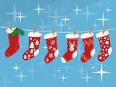 Christmas Socks Hanging On Rope Vector