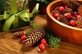 foto of christmas ornament  - Pine cones christmas balls and gifts on oak table - JPG