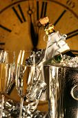 image of new years celebration  - Champagne in bucket with glasses ready for New Years festivities - JPG
