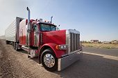 stock photo of oversize load  - Wide angle shot of an red truck - JPG