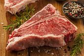 stock photo of porterhouse steak  - Thick Raw T - JPG