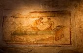picture of brothel  - Two thousand years old roman antique erotic fresco in Pompeii Italy