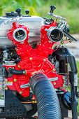 stock photo of suction  - Close up red color Fire fighting pump with suction hose
