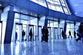 picture of person silhouette  - Entrance to modern building and people silhouettes - JPG