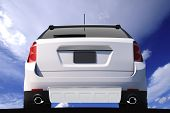 stock photo of rear-end  - Car Rear View on Cloudy Blue Sky - JPG