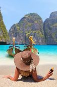 stock photo of phi phi  - Young woman at Maya bay Phi Phi Leh island - JPG