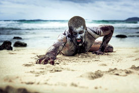 image of morbid  - young man with a zombie body painting - JPG