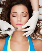 image of health center  - Woman getting laser face treatment in medical spa center - JPG