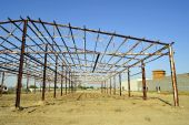 stock photo of purlin  - A steel skeleton structure is all that remains of a fire - JPG