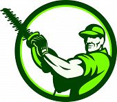 stock photo of trimmers  - Illustration of a tree surgeon arborist gardener tradesman worker holding a hedge trimmer facing front set inside circle done in retro style on isolated white background - JPG