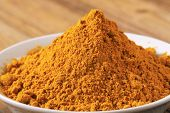 foto of garam masala  - macro detail of curry powder in the bowl - JPG