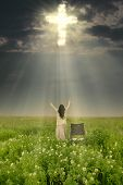 stock photo of sun god  - Woman with wheelchair is being healed by God - JPG
