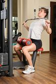 image of lats  - Handsome young man doing B lats pull - JPG