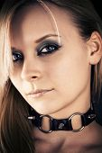 stock photo of sadistic  - portrait of a beautiful woman with a collar - JPG