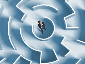 image of wise  - Top view of successful businessman standing in center of labyrinth - JPG