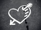 stock photo of enamored  - Abstract white heart painted on the dirty pavement - JPG
