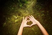 picture of sweethearts  - Child laying outdoors  making a heart shape - JPG