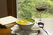 image of matzah  - Delicious Matzoh ball soup with crackers wine and dill - JPG