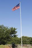 picture of emplacements  - NEW YORK - JULY 6:Old cannon and 15-star 15-stripe Star Spangled Banner American flag at Fort Jay on Governors Island in New York Harbor on July 6, 2014.