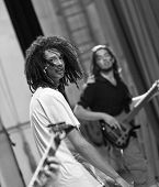foto of rasta  - rock singer with rasta hair performing live on stage OUT LOUD