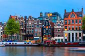 pic of gable-roof  - Night city view of Amsterdam canal typical dutch houses and boats Holland Netherlands - JPG