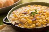 image of biscuits  - A bowl of homemade corn chowder with bacon potato and cheese biscuits - JPG