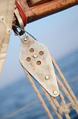 stock photo of pulley  - Pulley Blocks of mainsheet running rigging of old yacht - JPG