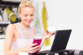 image of independent woman  - Business woman working from her home - JPG