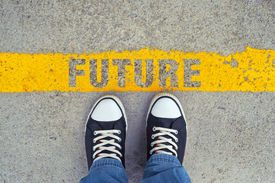 stock photo of future  - Male sneakers on the asphalt road with yellow line and title Future - JPG