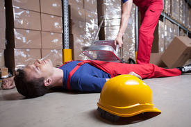 stock photo of unsafe  - Accident during work at height in factory