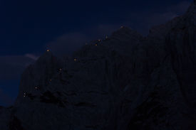 stock photo of flambeau  - torches on the top of the mountains at the midsummer festival in austria Wilder Kaiser - JPG