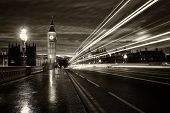stock photo of london night  - Monochrome Big Ben and London at night with the lights of the cars passing by after rain London and England - JPG