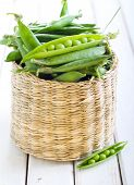stock photo of peas  - Peas in pea pods on table selective focus - JPG