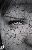 picture of drought  - womans face closeup with cracks - JPG
