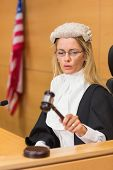 picture of court room  - Stern judge sitting and listening in the court room - JPG
