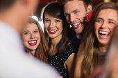 pic of over counter  - Drunk friends laughing with barman at the nightclub - JPG