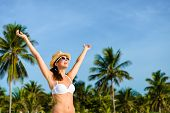 foto of caribbean  - Happy blissful woman in white bikini enjoying tropical beach and caribbean summer vacation - JPG