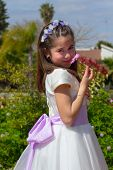 image of communion  - A young girl smiling and celebrating her First Holy Communion - JPG
