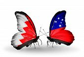 stock photo of samoa  - Two butterflies with flags on wings as symbol of relations Bahrain and Samoa - JPG