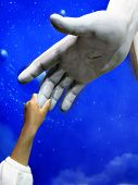 picture of spirit  - Little child holding hand of Jesus Statue showing faith spirit religion belief - JPG