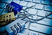 foto of cybercrime  - security locks with a fish hook on computer keyboard - JPG