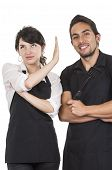 image of apron  - young attractive couple chefs wearing black apron isolated on white - JPG