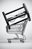 picture of grocery cart  - Hourglass in grocery cart on a light background - JPG