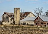 image of silos  - This is a old classic Amish barn with patchwork colors on the roof and a silo. ** Note: Soft Focus at 100%, best at smaller sizes - JPG