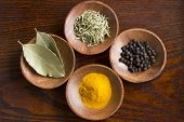 foto of bay leaf  - Dry herb served in wooden plate rosemary bay leaf black pepper turmeric - JPG