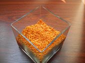 stock photo of crystal glass  - crystal orange prisms in a glass box as decoration  - JPG