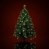 picture of tree trim  - Decorated Christmas tree on a dark red  background - JPG