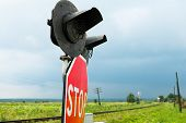 pic of traffic sign  - Traffic lights stops sign and crossbuck sign at the railroad crossing in Ukraine - JPG